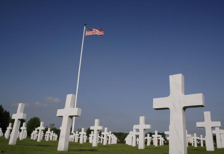 Headstones and American flag, Somme American Cemetery.