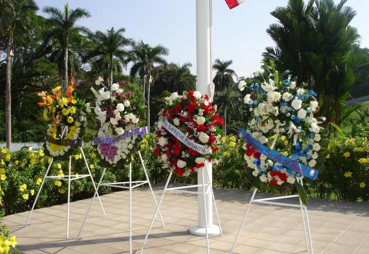 Floral wreaths laid during the ceremony.