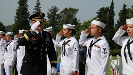 Sailors salute an Army officer during the ceremony.