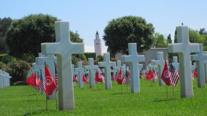 Flags at headstones at North Africa American Cemetery for Memorial Day 2012.
