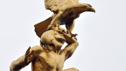 A close-up of an American Indian holding an eagle sits atop Tours American Monument.