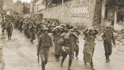 U.S. soldiers escort German prisoners of war, June 28, 1944.