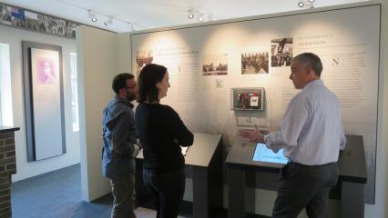 Superintendent Chris Arseneault explains one of the new exhibit panels.