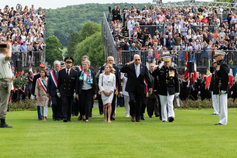 Men and women walk in at the beginning of the ceremony.