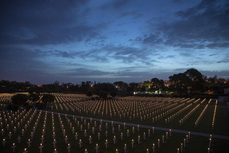 Thousands of headstones had burning candles on top for the Luminary.