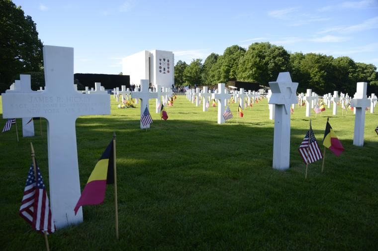 Flags are seen in front of every headstone.