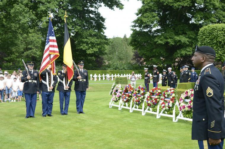 Men in uniform serve as the Honor Guard.