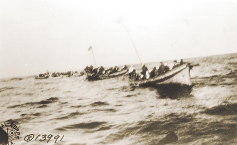 Survivors of the USS President Lincoln drift in lifeboats after a German submarine sank her.