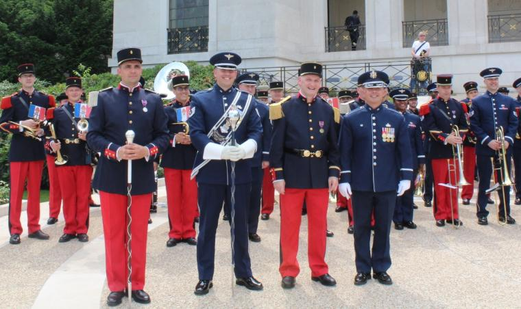 Men and women in uniform hold their instruments.
