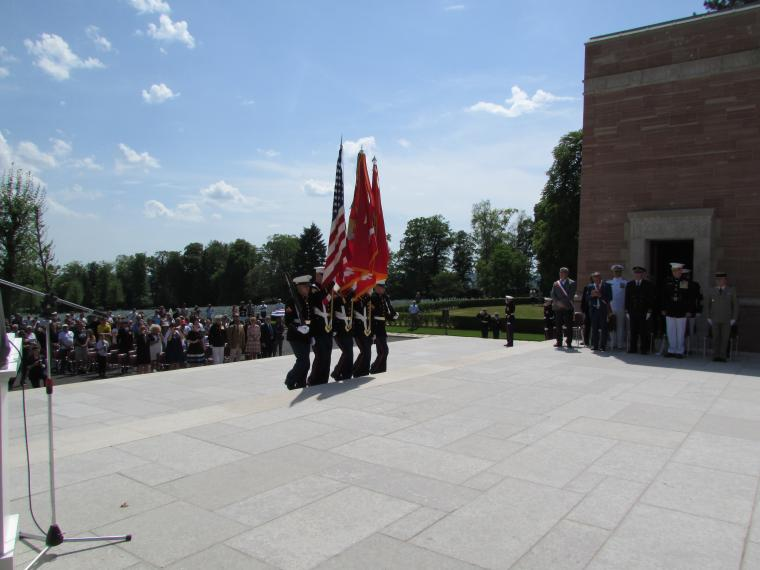 Marines carry flags or weapons as they serve in the honor guard.