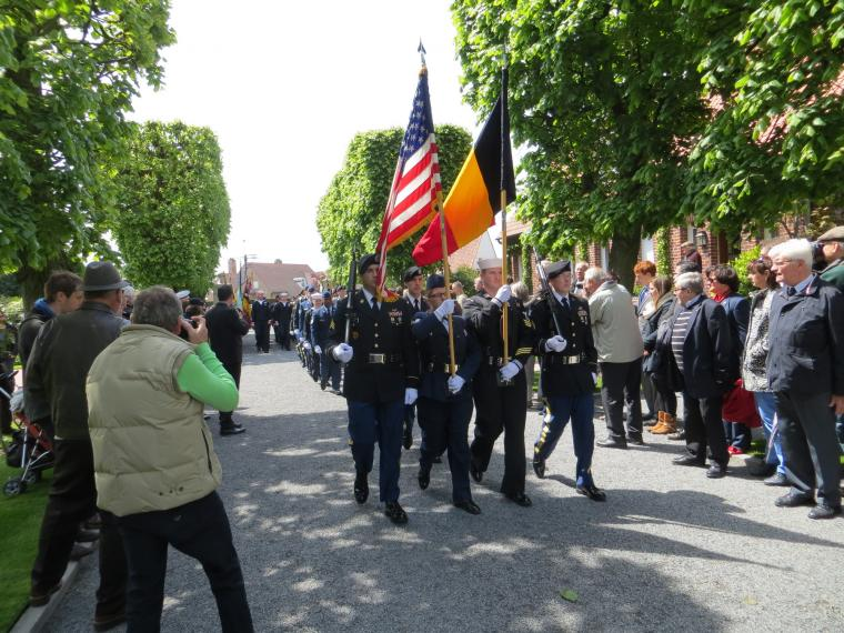 U.S. Color Guard marches into cemetery.