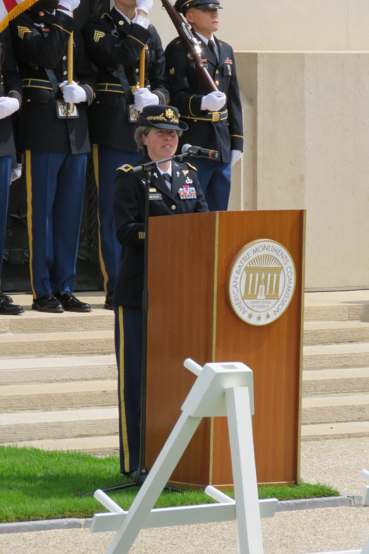 The chaplain delivers her remarks from the podium.