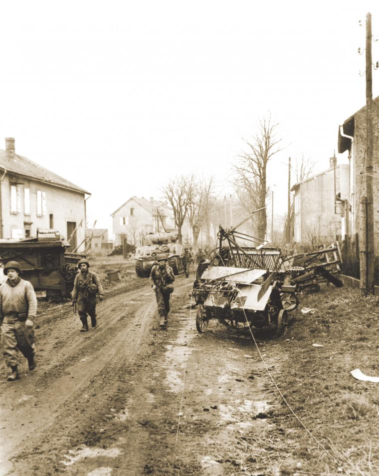 U.S. soldiers pursue German forces on the outskirts of Metz.