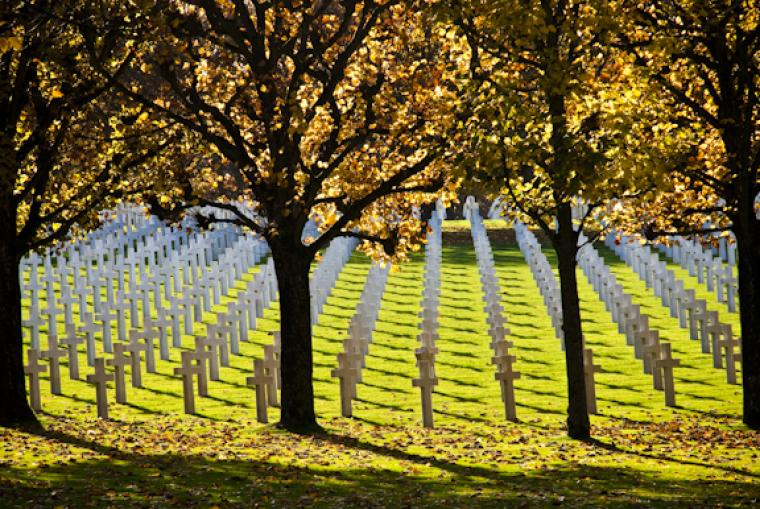Rows of headstones in autumn at Meuse-Argonne American Cemetery.