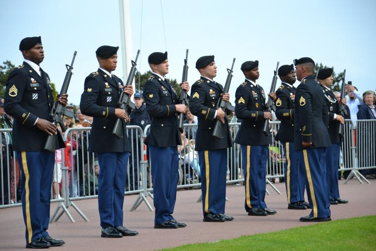 A firing detail participates in the 2012 Memorial Day ceremony at Normandy American Cemetery.