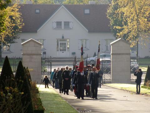 Participants march into the cemetery for the ceremony.