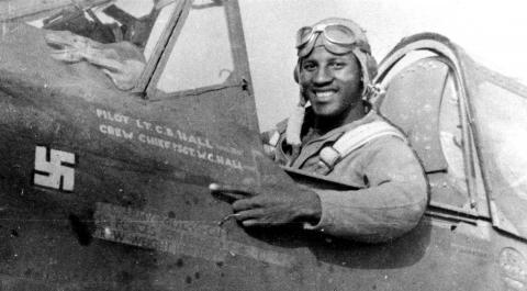 Historic photo showing Hall sitting in the cockpit of his fighter.