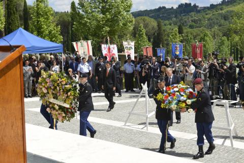 Members of the military assist in the wreath laying.