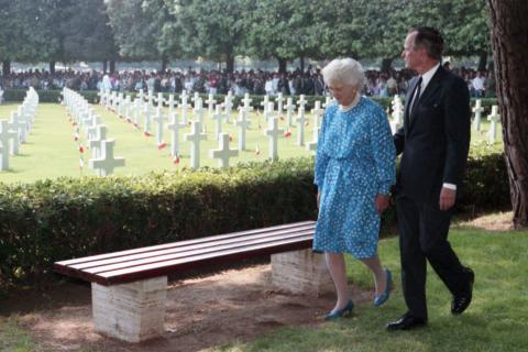 President Bush and his wife walk through Sicily-Rome American Cemetery.