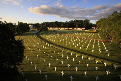 Sweeping arcs of headstones dot the landscape at Cambridge American Cemetery.