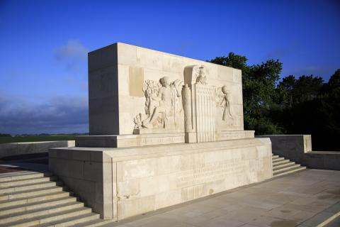 The Bellicourt Monument, which is made of stone, includes relief sculptures on the facade.