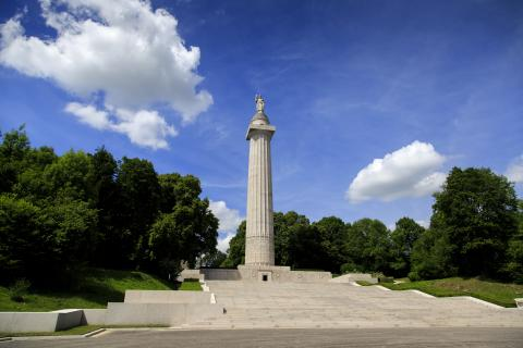 The 200 ft stone column rises high above the landscape.
