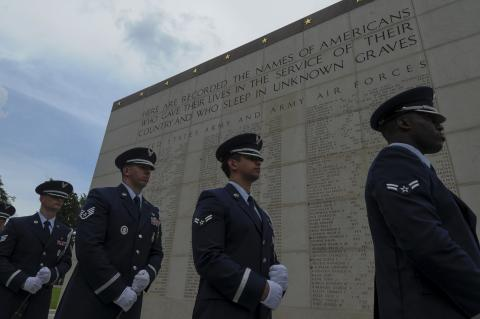 Members of the Air Force stand in front of the Wall of the Missing.