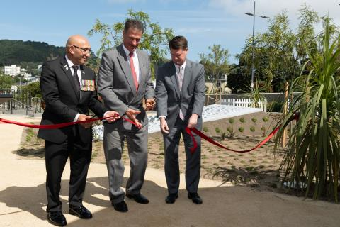 Men cut ribbon to dedicate memorial