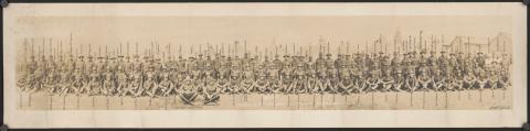 Historic photo shows unit photo of men in uniform from the 115th U.S. Infantry.