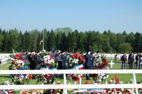 Members of the military salute during the 2012 Memorial Day ceremony at Ardennes American Cemetery.