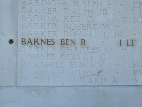 The name and rank of 1st Lt. Ben B. Barnes is highlighted on a stone wall.