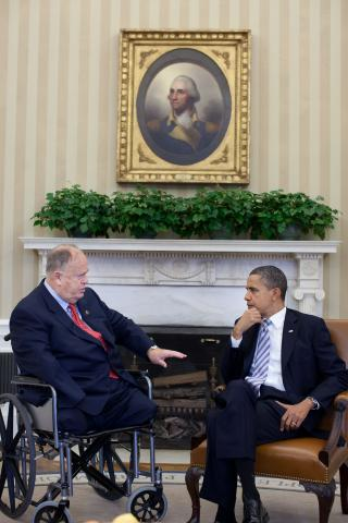 Secretary Cleland sits with President Obama in the Oval Office.