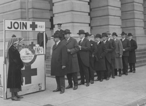Historic photo shows lawmakers standing outside in line at Red Cross booth.