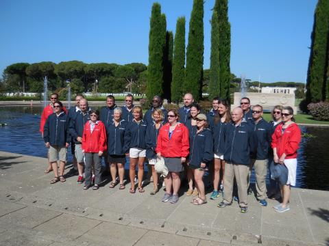 The teachers gather at the reflecting pool for a group photo.