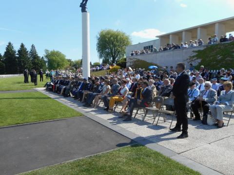Attendees sit in chairs during the ceremony.