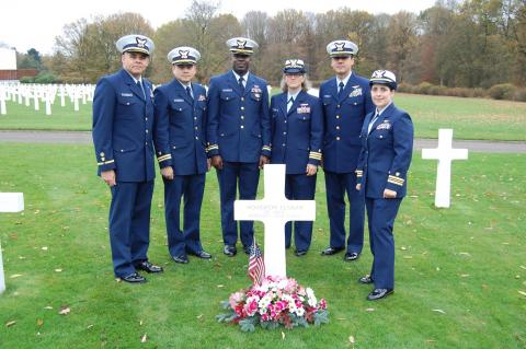 Six members of the Coast Guard stand at Elaman's headstone.