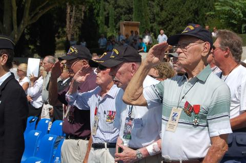 WWII veterans salute during the ceremony.