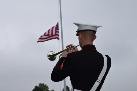 A Marine plays the trumpet during the ceremony.