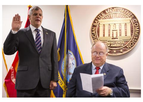 Dalessandro raises right hand for swearing in by Cleland.