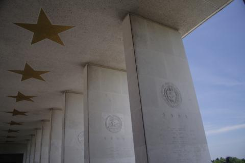 Columns and inlaid stars outside the memorial building at Henri-Chapelle American Cemetery.