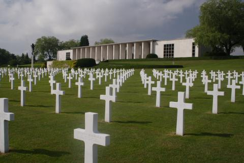 Headstones in front of the memorial building at Henri-Chapelle American Cemetery.