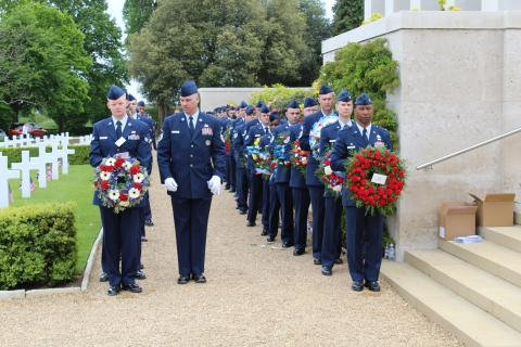 Members of the Air Force carry floral wreaths during the ceremony.