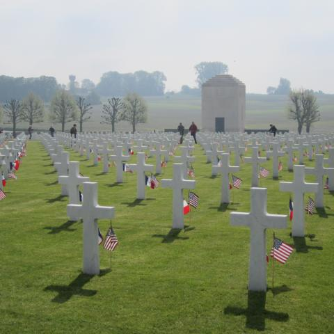 A French and an American flag are located in the ground in front of every headstone.