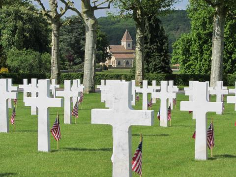 American and French flags stand in front of every marble headstone.