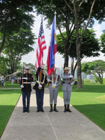 An Honor Guard stands at attention during the ceremony.