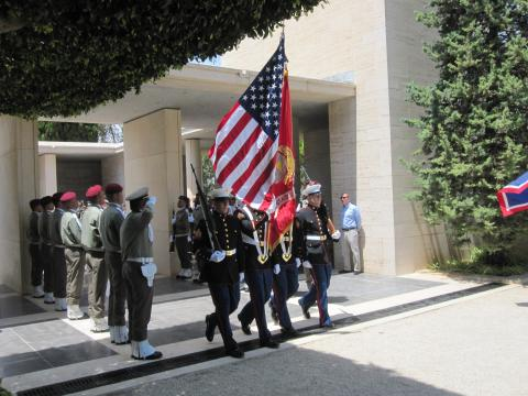 A color guard marches in with the American flag.