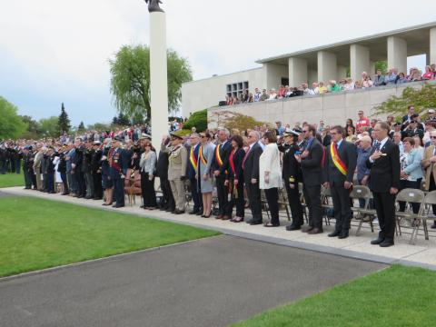 Members of the crowd stand during the ceremony.