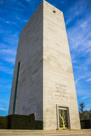 A tall brick building houses the chapel at Netherlands American Cemetery
