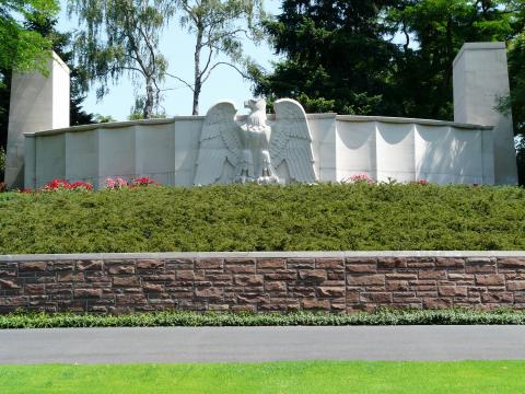 An eagle sculpture adorns the entrance to Lorraine American Cemetery.