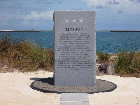 "This monument, a granite ""memory stone,"" is etched with a historical tribute to America's armed forces."